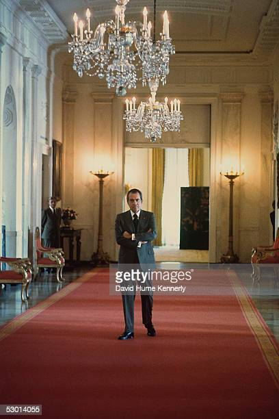 US President Richard Nixon waits in the hallway outside the East Room of the White House to give a press conference in January 1974 Washington DC