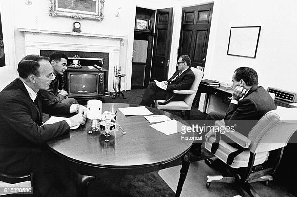 President Richard Nixon watches Apollo 13 splash down with National Security Advisor Henry Kissinger Collins and Anders April 17 1970