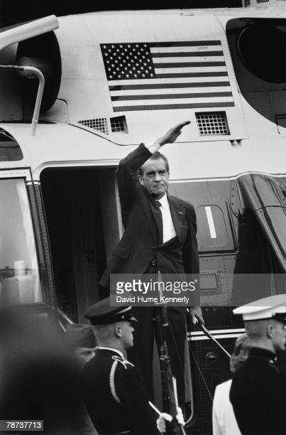 President Richard Nixon waves goodbye as he leaves the White House for the last time August 9 1974 in Washington DC