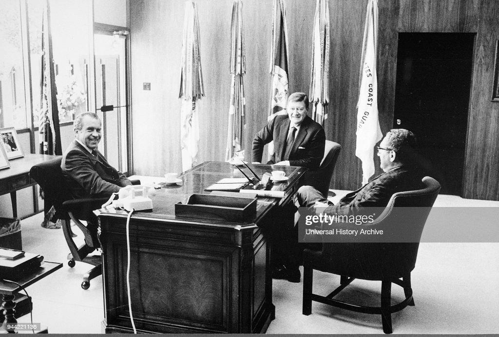 US President Richard Nixon with John Wayne and Henry Kissinger in the White House. : News Photo