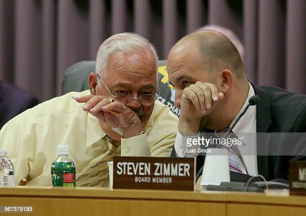 President Richard Vladovic left and board member Steven Zimmer confer during a meeting Tuesday Oct 14 about proposals for resolving classscheduling...