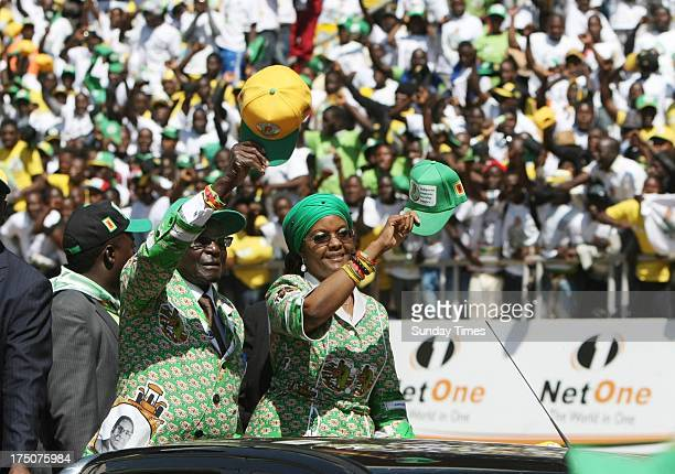 President Robert Mugabe and his wife Grace arrive at a ZANU PF rally on July 28 2013 in Harare Zimbabwe The Zimbabwean President held his final...
