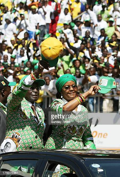 President Robert Mugabe and his wife Grace during during a ZANU PF rally on July 28 2013 in Harare Zimbabwe The Zimbabwean President held his final...