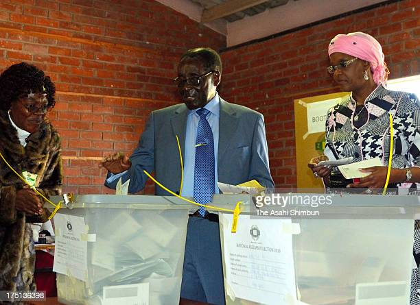 President Robert Mugabe casts a ballot at a vote center during the presidential election on July 31 2013 in Harare Zimbabwe The result will be...