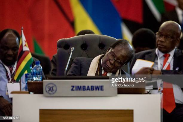 President Robert Mugabe of the Republic of Zimbabwe rests at the Opening Session of the 37th Southern African Development Community Summit of Heads...
