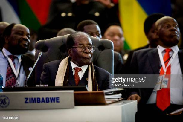 President Robert Mugabe of the Republic of Zimbabwe watches a dance performance at the Opening Session of the 37th Southern African Development...