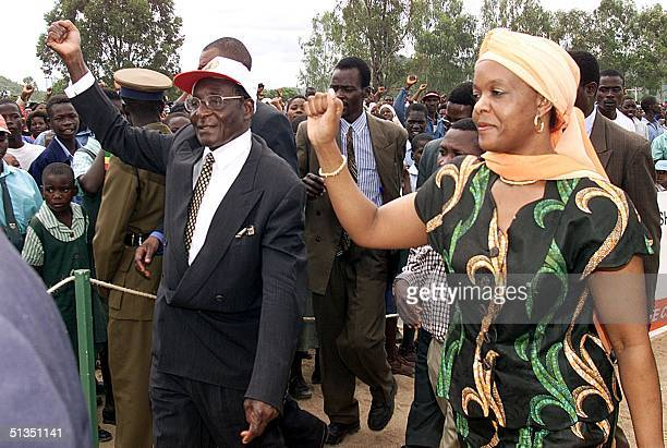 President Robert Mugabe of Zimbabwe and his wife Grace greet supporters at the first election rally for the president's ruling ZANUPF party in the...