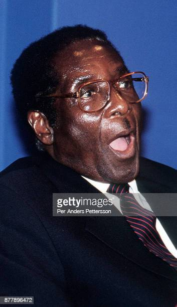President Robert Mugabe of Zimbabwe reacts to a question from a reporter at a press conference on February 11 2000 in Harare Zimbabwe Mugabe was a...