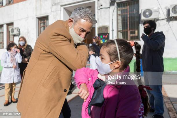 """President Robert Silva greets a student during a break at the """"Japon"""" public school number 72 during the first day of the final phase of the gradual..."""