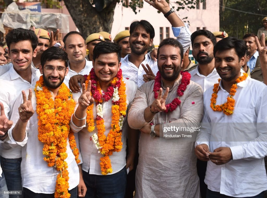 President Rocky Tuseed (3R) and Vice-president Kumal Sehrawat (3L) with NSUI supporters after election results during the DUSU Election result at Arts Faculty in North Campus, Delhi University, on September 13, 2017 in New Delhi, India. Congress-backed National Students Union of India (NSUI) staged a comeback on the DU campus by bagging two posts - President and Vice-president - in Delhi University Students Union (DUSU) polls. The RSS-backed Akhil Bharatiya Vidyarthi Parishad (ABVP) which had won three seats last year, including that of the president, could only win posts of secretary and joint secretary.