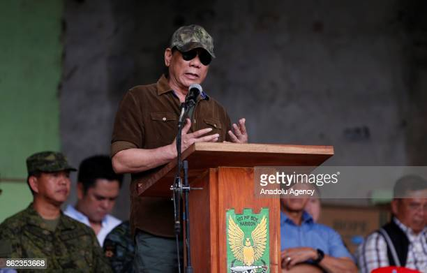 President Rodrigo Duterte addresses soldiers as he declares the liberation of the Marawi from Daesh-linked Maute terrorists, in Marawi City in the...