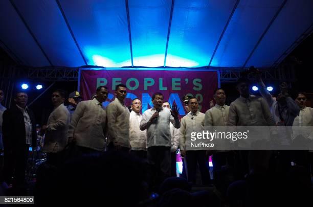 President Rodrigo Duterte speaks to protesters outside Congress during a rally coinciding President Rodrigo Duterte's annual State of the Nation...