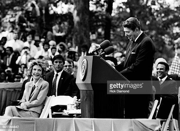 President Ronald Reagan addresses First Lady Nancy Reagan Former President Jimmy Carter Former First Lady Rosalynn Carter during the Carter Center...