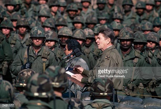 US President Ronald Reagan addresses US troops November 13 1983 at Camp Liberty Bell the DMZ South Korea