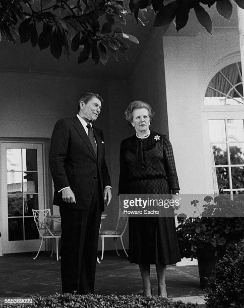 President Ronald Reagan and British Prime Minister Margaret Thatcher talking in the Rose Garden outside the Oval Office, at the White House in...