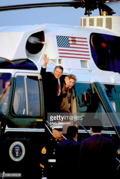 President Ronald Reagan and First Lady Nancy Reagan wave from the doorway of Marine One as they prepare to depart the White House South Lawn enroute...