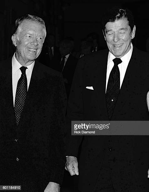 President Ronald Reagan and Former President Jimmy Carter chat during the Carter Center Presidential Center Dedication in Atlanta Georgia October 1...