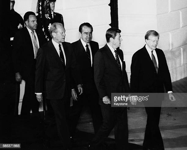 President Ronald Reagan and former Presidents Jimmy Carter Richard Nixon and Gerald Ford pictured leaving the White House as the former Presidents...