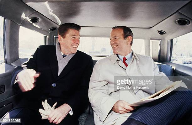President Ronald Reagan and his Chief of Staff James Baker ride in the presidential limousine in 1981 in Washington DC