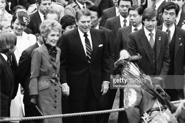 US President Ronald Reagan and his wife Nancy enjoy Yabusame horseback archery with Crown Prince Akihito and Crown Princess Michiko at Meiji Jingu...