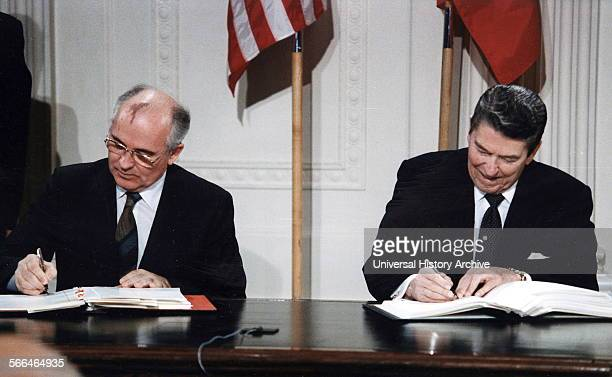 US President Ronald Reagan and Soviet General Secretary Mikhail Gorbachev signing the INF Treaty in the East Room at the White House in 1987 The...