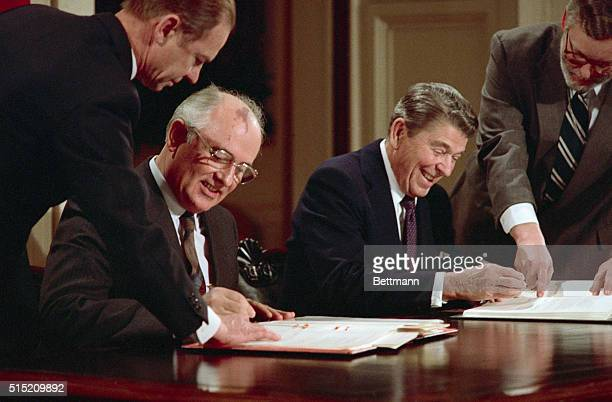 President Ronald Reagan and Soviet leader Mikhail Gorbachev signing the arms control agreement banning the use of intermediate-range nuclear...