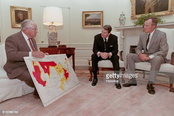 President Ronald Reagan and Vice President George Bush examine a map of drought areas in the US shown by Secretary of Agriculture Richard Lyng