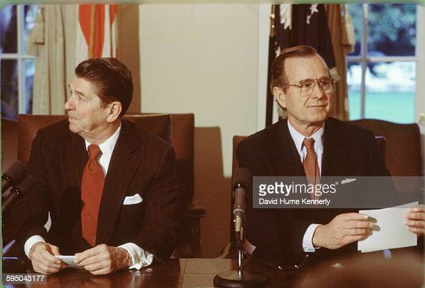 President Ronald Reagan and Vice President George HW Bush during a meeting in the White House Cabinet Room circa 1983 in Washington DC