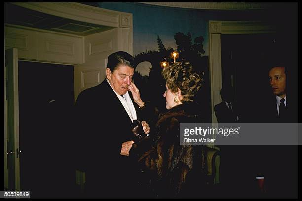 President Ronald Reagan and wife Nancy awaiting arrival of Soviet Leader Mikhail Gorbachev for USSoviet Summit