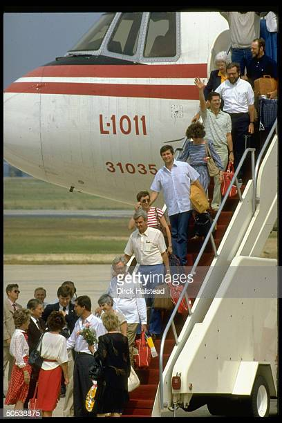 President Ronald Reagan and wife Nancy greeting former hostages of TWA flight 847 as they debark from plane at Andrews Air Force Base