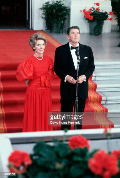 US President Ronald Reagan and wife Nancy greeting the press at the North Portico of the White House May 7 1981 in Washington DC