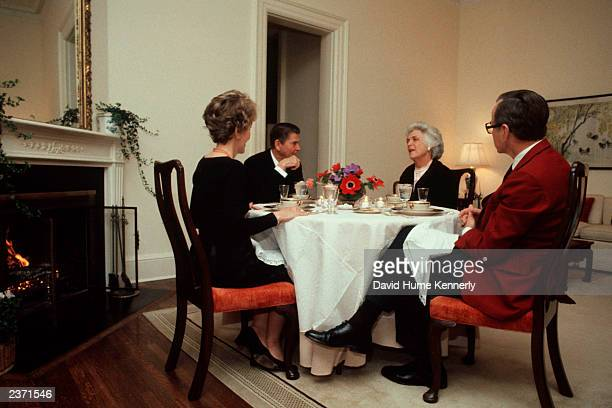 President Ronald Reagan and wife Nancy have lunch with Vice President George H.W. Bush and wife Barbara in the Vice President's residence February...