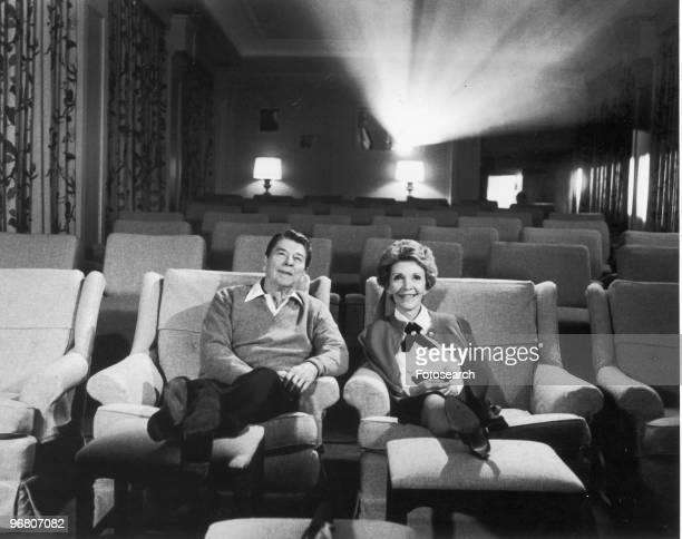 President Ronald Reagan and wife Nancy Reagan sitting in their screening room circa 1980s