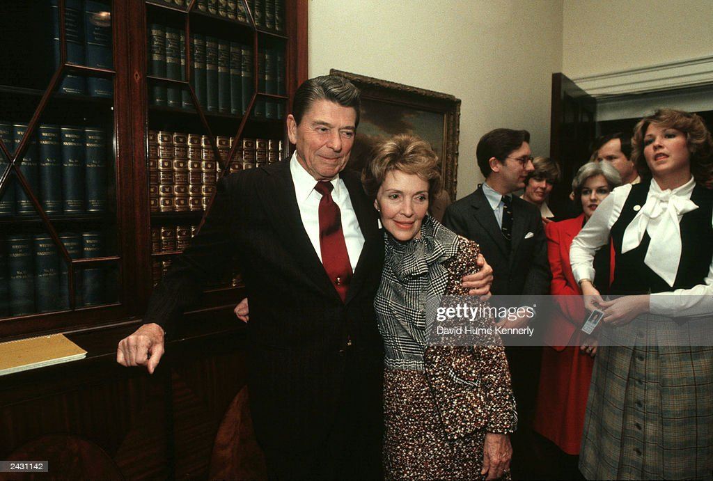 U.S. President Ronald Reagan and wife Nancy stand in the Roosevelt Room of the White House during a birthday party for Presidential Advisor Ed Meese in 1982 in Washington, DC.