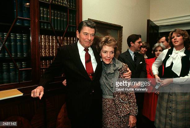 US President Ronald Reagan and wife Nancy stand in the Roosevelt Room of the White House during a birthday party for Presidential Advisor Ed Meese in...