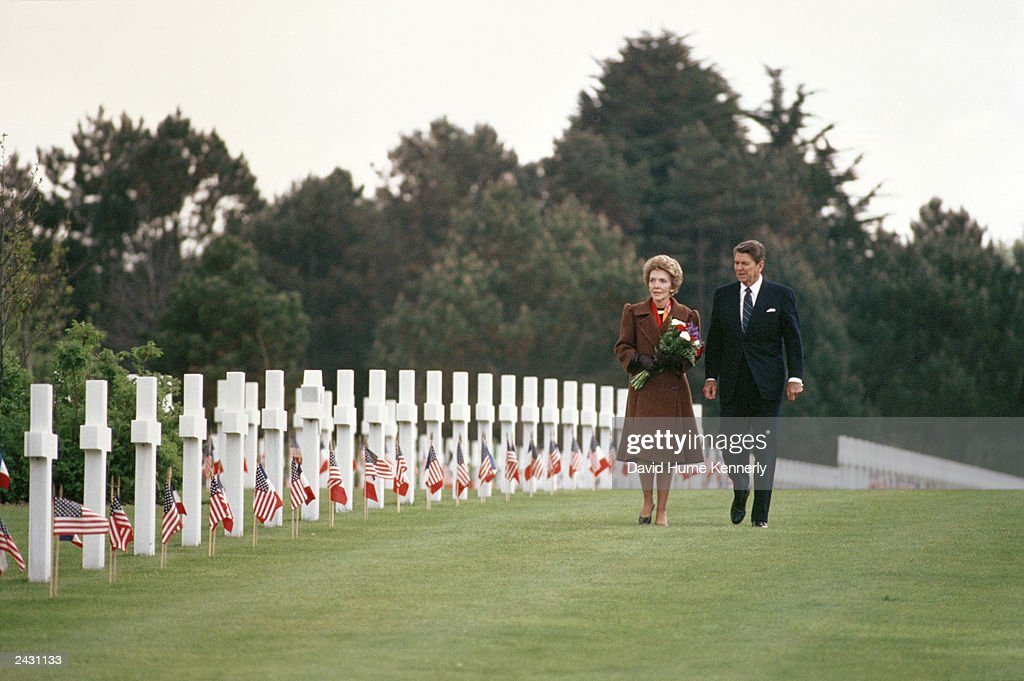 U.S. President Ronald Reagan and wife Nancy walk among the crosses of the Normandy American Cemetery June 6, 1984 in Normandy, France. Reagan is visiting France on the occasion of the 40th anniversary of the Omaha Beach invasion, otherwise known as 'D-Day' on June 6, 1944.