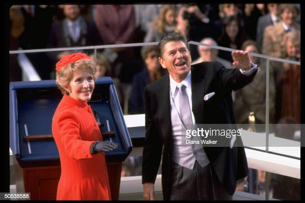 President Ronald Reagan and wife Nancy waving to crowd after swearingin