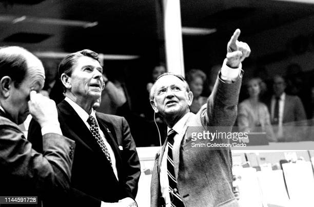 President Ronald Reagan briefed by JSC Director Christopher C Kraft Jr at the Johnson Space Center's Mission Control Center Houston Texas November 13...