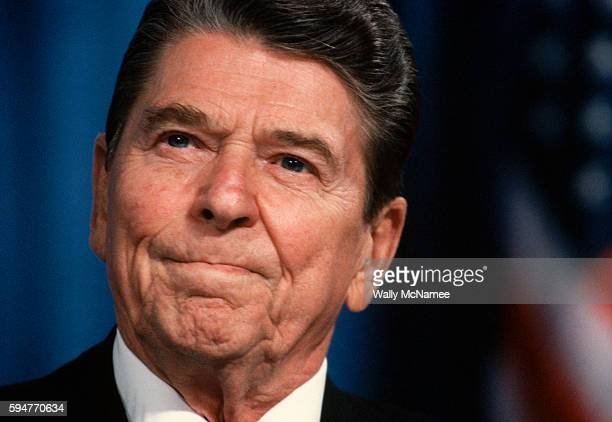 President Ronald Reagan campaigning for 1988 Republican presidential candidate George Bush makes a face during a speech at a rally in Cincinnati