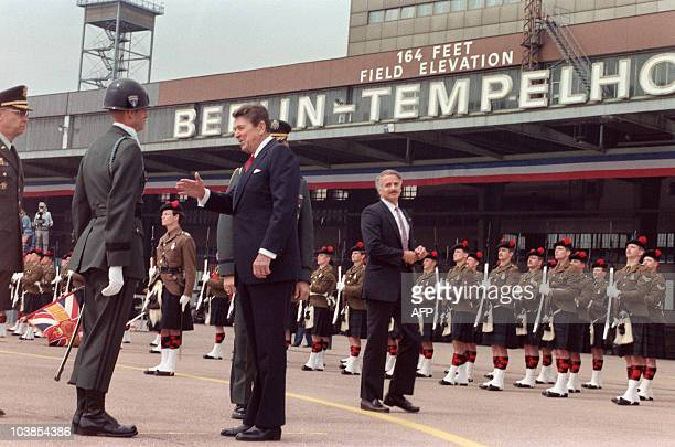 President Ronald Reagan, commemorating the 750th anniversary of Berlin, reviews honor guard of Royal Regiment of Scotland on June 12, 1987 after his...