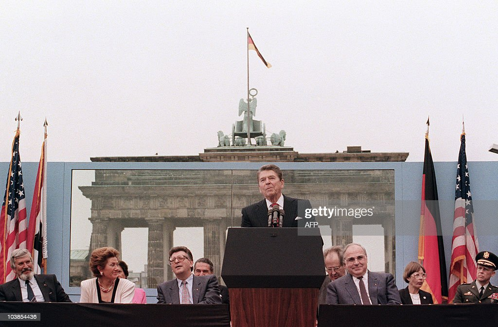 US President Ronald Reagan, commemorating the 750th anniversary of Berlin, addresses on June 12, 1987 the people of West Berlin at the base of the Brandenburg Gate, near the Berlin wall. Due to the amplification system being used, the President's words could also be heard on the Eastern (Communist-controlled) side of the wall. 'Tear down this wall!' was the famous command from United States President Ronald Reagan to Soviet leader Mikhail Gorbachev to destroy the Berlin Wall. The address Reagan delivered that day is considered by many to have affirmed the beginning of the end of the Cold War and the fall of communism. On Nov. 9-11, 1989, the people of a free Berlin tore down that wall. West German Chancellor Helmut Kohl is 3rd-right.