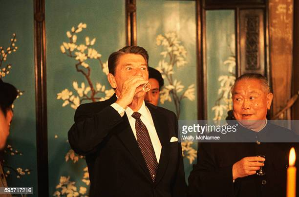 President Ronald Reagan drinks a glass of mao tai a potent sorghumbased Chinese liqueur as part of a toast during Reagan's 1984 state visit to the...
