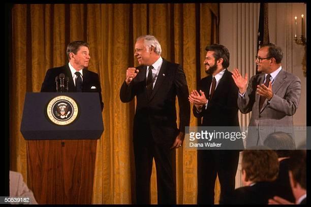 President Ronald Reagan giving speech as Nicaraguan Contra leaders Adolfo Calero Alfonso Robelo Arturo Cruz stand next to him at reception for Contra...