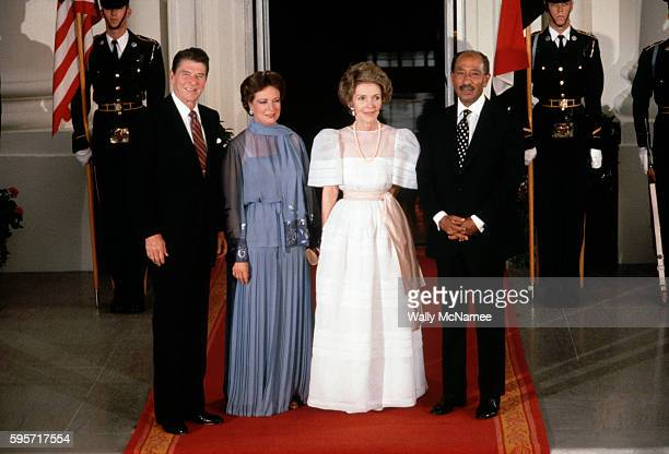 President Ronald Reagan Jihan Sadat First Lady Nancy Reagan and Egyptian President Anwar Sadat stand on the red carpet at the North Portico of the...
