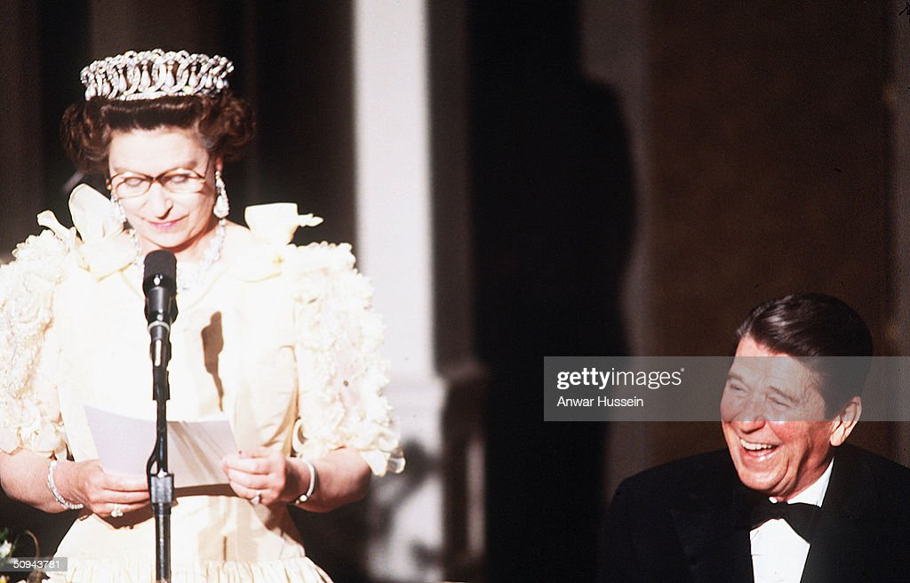 President Ronald Reagan laughs as Her Majesty Queen Elizabeth II delivers a speech during a banquet in March 1983 in San Francisco, California.