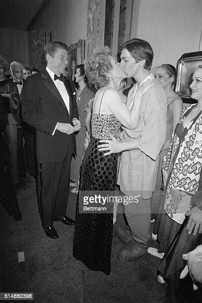 President Ronald Reagan looks on as a proud First Lady kisses their son, Ron, following a performance of the Joffrey Ballet. The performance was the...