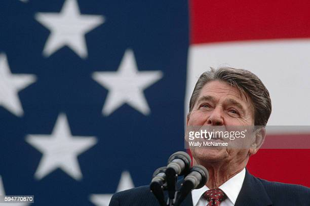 President Ronald Reagan makes a stump speech in front of a large American flag