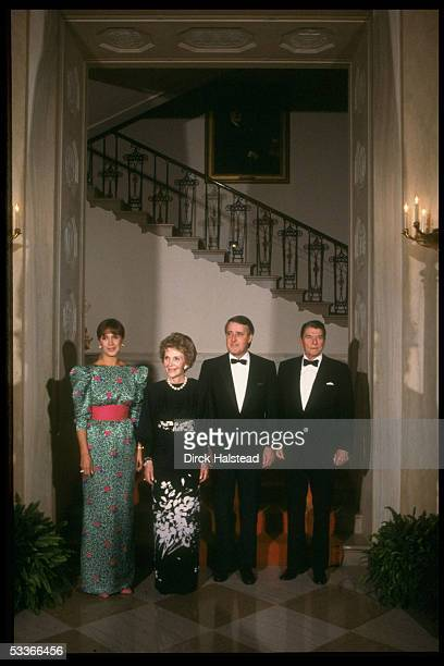 President Ronald Reagan Nancy Reagan with Canadian PM Brian Mila Mulroney men in black tie ladies in fancy gowns during WH state dinner