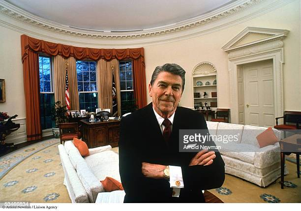 President Ronald Reagan poses for portrait in the Oval Office at the White House December 14 1981 in Washington DC