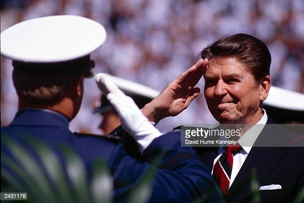 US President Ronald Reagan salutes West Point military academy graduates May 27 1981 in West Point NY
